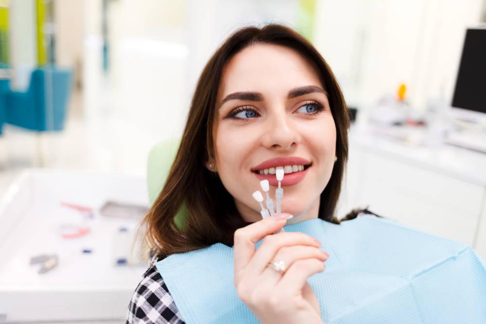 girl-chooses-color-veneers-dentist-office